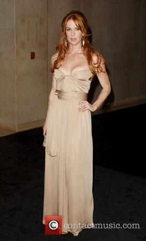 Poppy Montgomery  the 2011 Women In Film Crystal + Lucy Awards at the Beverly Hilton Hotel Beverly Hills, California...