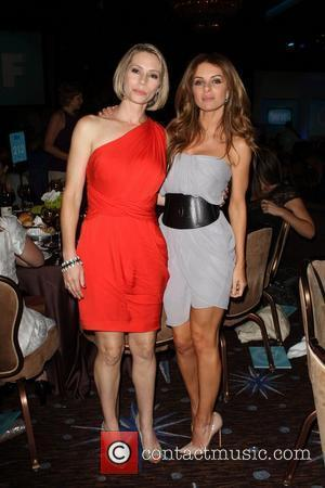 Meredith Monroe and Joey Tierney  The 2011 Women In Film Crystal + Lucy Awards at the Beverly Hilton Hotel...
