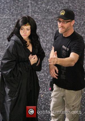 Adrianne Palicki talks with a production member whilst filming scenes for 'Wonder Woman'  Hollywood, California - 31.03.11