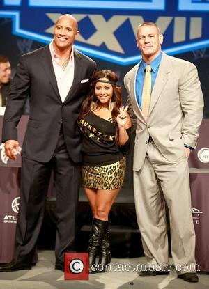 Dwayne Johnson aka The Rock, Nicole Polizzi aka Snooki and John Cena attend a press conference with WWE superstars for...