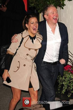 Caroline Flack and Louis Walsh seen outside of X Factor studios after a live show London, England - 30.10.11