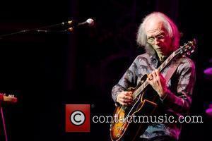 Steve Howe of English progressive rock band Yes ,  performing live at Coliseu dos Recreios Lisbon, Portugal - 03.11.11