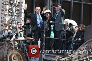 Hamish Dodds, Yoko Ono and Bill Ayres on top of the Hard Rock Cafe marquee as they launch the 'Imagine...