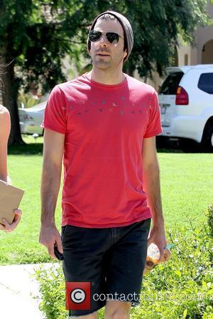 Zachary Quinto returning to his newly purchased car after running errands with a friend Los Angeles, California - 05.04.11