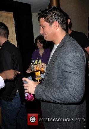 Alex Reid enjoys drinks from the free bar  UK premiere of 'Zebra Crossing' at the Empire Leicester Square London,...