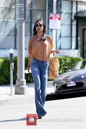 Zoe Saldana looking very stylish is seen as she exits an entertainment office in Beverly Hills Los Angeles, California -...
