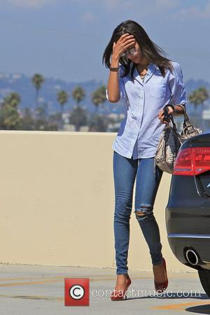 Zoe Saldana is seen arriving at an office building in Santa Monica looking very casual chic Los Angeles, California -...