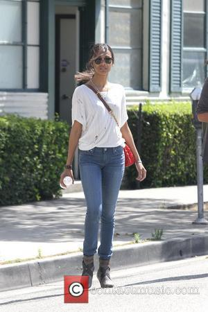 Zoe Saldana is seen toting a stylish Lanvin handbag as she leaves a building in Beverly Hills Los Angeles, California...
