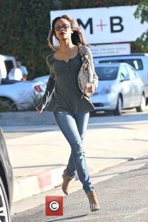 Zoe Saldana runs to her car after leaving a hair salon in West Hollywood Los Angeles, California - 02.11.11
