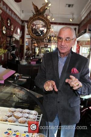 Fredric Prinz Von Anhalt picks up a chocolate birthday cake for his wife Zsa Zsa Gabor at La Conversation in...