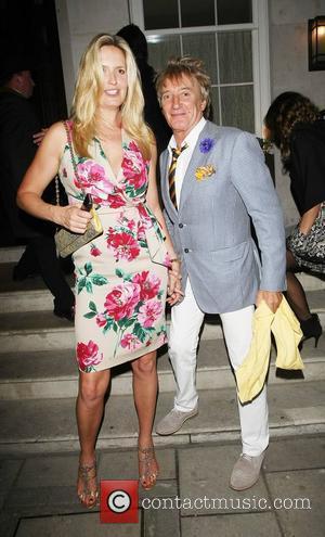 Rod Stewart Overcomes Camera Shyness By Ogling Wife's Legs