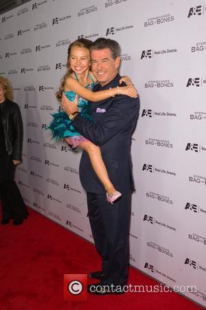 Pierce Brosnan and Caitlin Carmichael