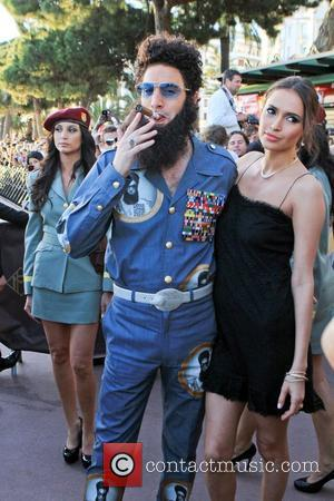Sacha Baron Cohen dressed as Admiral General The Dictator  poses on the Croisette during the 65th Cannes Film Festival...