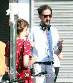 Director John Carney filming on the set of his new movie 'Can A Song Save Your Life?' in Manhattan. The...