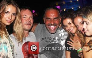 Lord Baltimore designer Christian Audigier parties with Pete Tong during Dj Luciano's Vagabundos open air party at Ushuaia Ibiza, Spain...