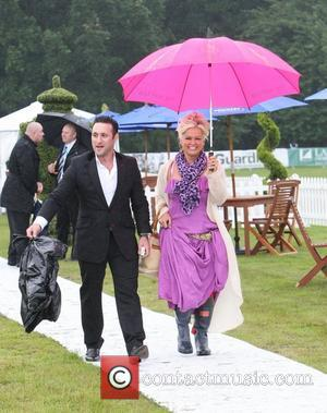 Antony Costa and guest arrive for the 2012 Duke of Essex Polo Trophy at Gaynes Park, Epping Essex, England -...