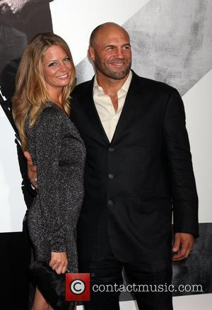 Randy Couture and Anne-Marie Stanley at the Los Angeles Premiere of The Expendables 2 at Grauman's Chinese Theatre. Hollywood, California...