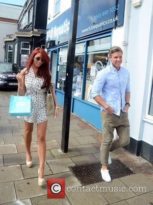 Amy Childs And David Peters at the opening of 'Harry's World', a new fashion boutique owned by Harry Derbidge from...