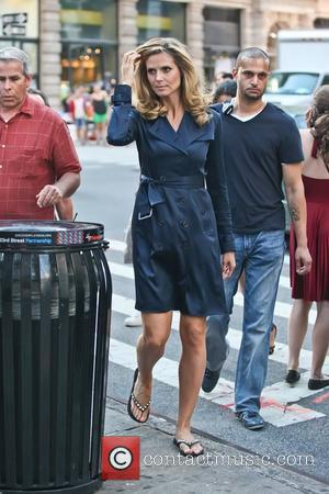 Heidi Klum filming on the set of a commercial for a German hair care product called Belladonna outside the Flatiron...