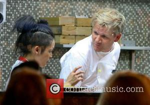 Gordon Ramsay with trainee chef Gun in the restaurant at Hotel GB London, England - 02.10.12