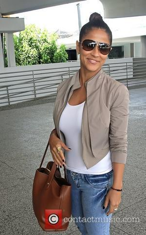 Univision weather anchor Jackie Guerrido leaving Luis M Marin Airport in Carolina  Puerto Rico - 15.04.12