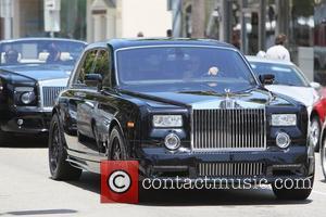 Husband of Petra Ecclestone, James Stunt seen driving his Rolls Royce Phantom convertible, through Beverly hills escorted by his bodyguard...