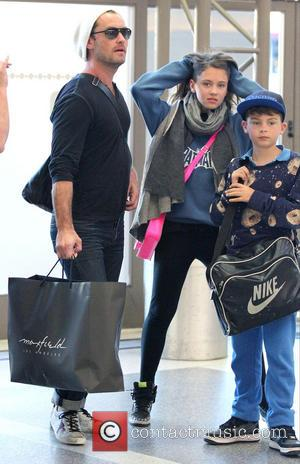 Jude Law; Iris Law; Rudy Law Jude Law with his daughter Iris and son Rudy arrive at Los Angeles International...