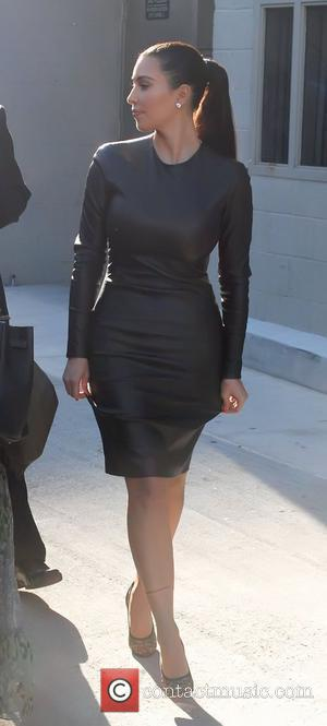 Kim Kardashian's Curves Split Skin-tight Dress