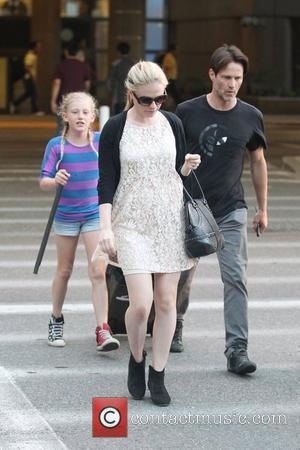 Stephen Moyer and his daughter Lilac pick up a pregnant Anna Paquin at LAX airport after she arrived on a...