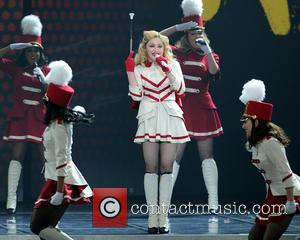 Madonna performs live in concert during the last city stop of her 2012 North American tour at The American Airlines...