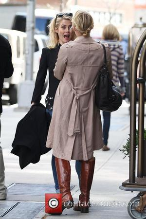 Rachael Taylor meets a friend as she leaves her Soho hotel in lower Manhattan New York City, USA - 02.04.12