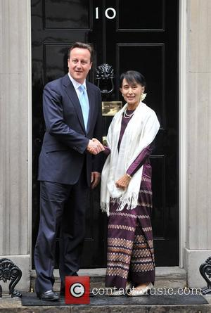 British Prime Minister David Cameron (L) meets Burmese opposition politician Aung San Suu Kyi (R) at 10 Downing Street. London,...