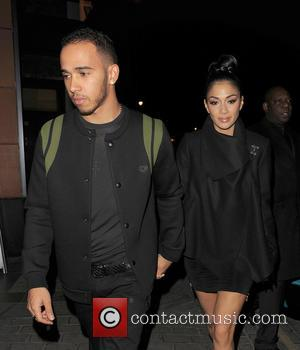 Nicole Scherzinger and boyfriend Lewis Hamilton leaving Zuma restaurant in Knightsbridge, just before midnight, following a late dinner.