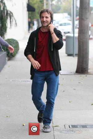 Breckin Meyer talks on his mobile phone while walking on Melrose West  Featuring: Array