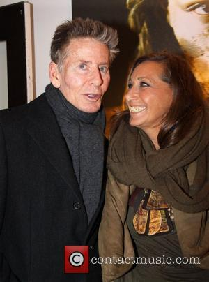 Calvin Klein and Donna Karan attend the Nomad Two Worlds Russell James Exhibit Opening at the Chair and The Maiden...