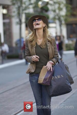 Shawn King Shawn King out christmas shopping at The Grove wearing brown leather jacket and matching felt hat  Featuring:...