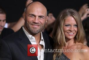 Randy Couture and Anne-Marie Stanley  at the Los Angeles Premiere of The Expendables 2 at Grauman's Chinese Theatre. Hollywood,...