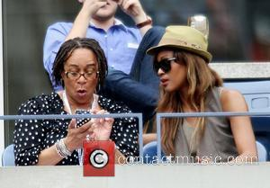 S. Epatha Merkerson and Singer Chantal watch Andy Roddick (USA) lose to Juan Martin Del Potro of Argentina after their...