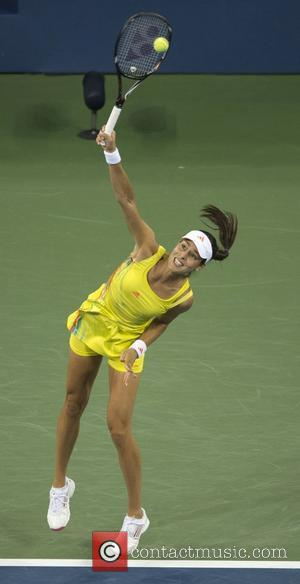 Ana Ivanovic of Serbia in action against Serena Williams of the USA in the women's singles quarterfinal match on Day...