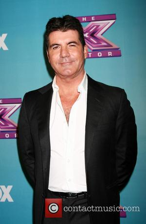 It's (Practically) Official: Simon Cowell And Carmen Electra Are Dating!