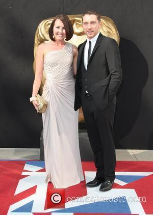 Rebecca Atkinson and Ben Batt The 2012 Arqiva British Academy Television Awards (BAFTAs), held at the Royal Festival Hall -...