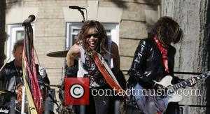 Aerosmith perform in front of 1325 Commonwealth Ave. which was their home in the early 1970's. Boston, USA -05.11.12.