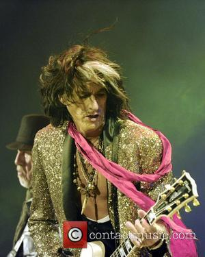 Joe Perry  Aerosmith performs at the Air Canada Centre during The Global Warming Tour.  Toronto, Canada - 27.06.12