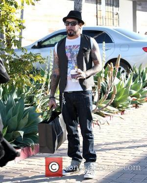 A. J. McLean smoking a cigarette as he leaves Maxfield clothing store in Malibu after shopping Los Angeles, California -...