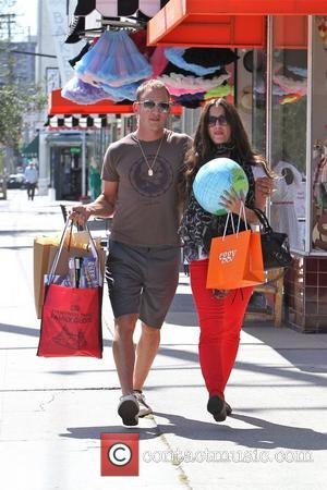 Alanis Morissette and her husband Mario Treadway  seen holding shopping bags and a Plush Earth Globe Los Angeles, California...