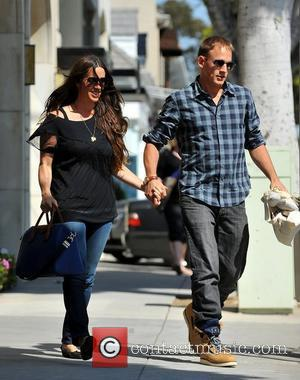 Alanis Morissette and Mario Treadway aka MC Souleye out and about in Santa Monica Santa Monica, California - 02.03.12