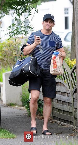 Alex Reid returns home after training holding a McDonalds food bag Essex, England - 27.06.12