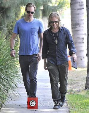 Alexander Skarsgard takes a walk with a friend through West Hollywood. The 'True Blood' star was recently revealed to be...