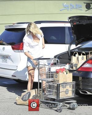 Ali Larter leaves Whole Foods in West Hollywood. The actress had a wardrobe malfunction after accidentally dropping one of her...