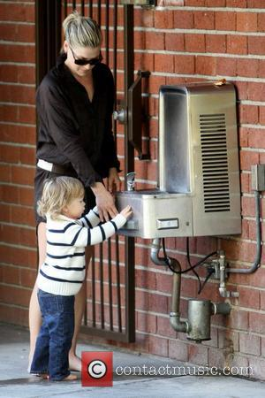 Ali Larter helps her son Theodore MacArthur get water from a fountain at Coldwater Canyon Park Los Angeles, California -...